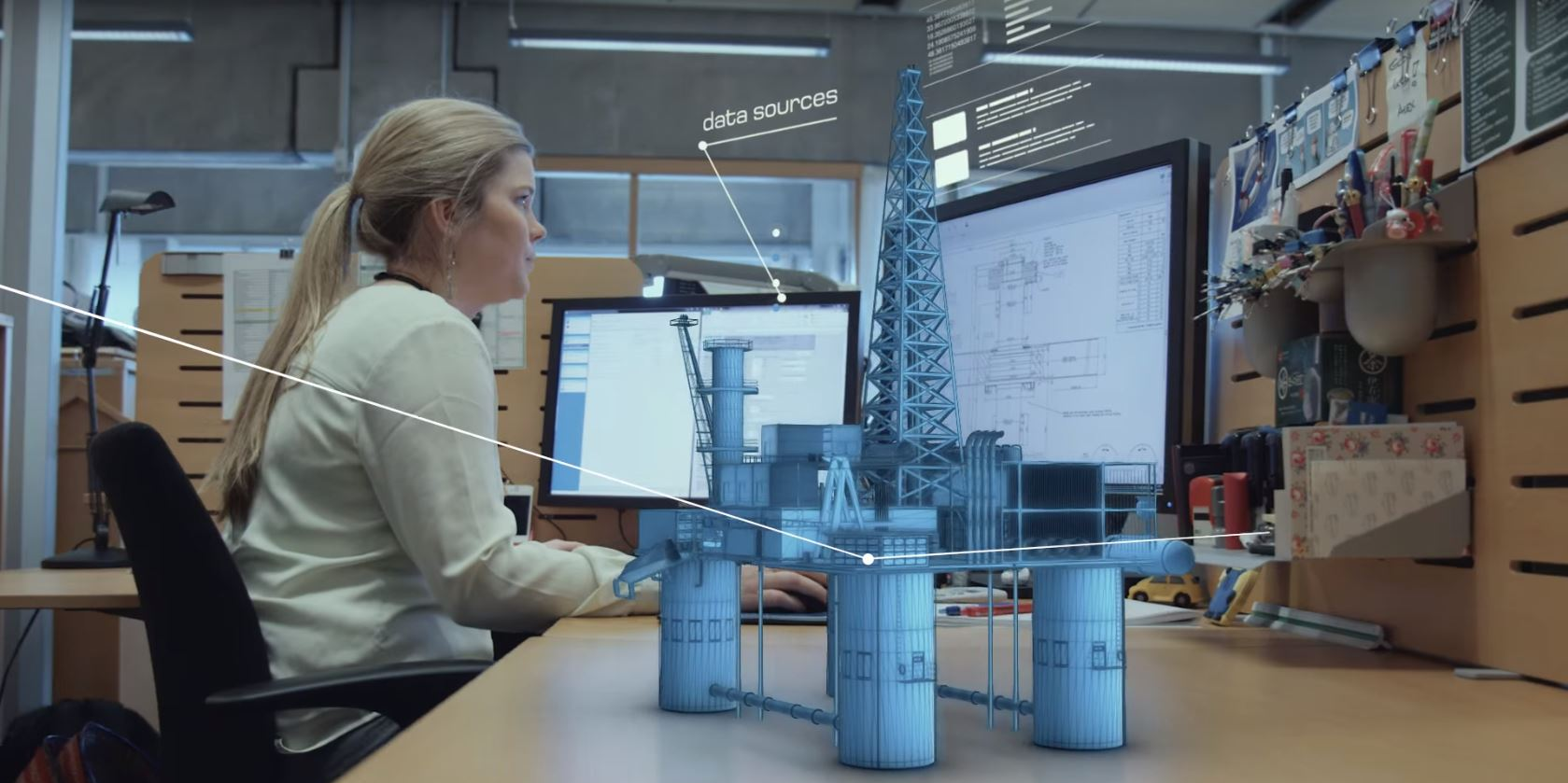 Digital twin on desk with woman