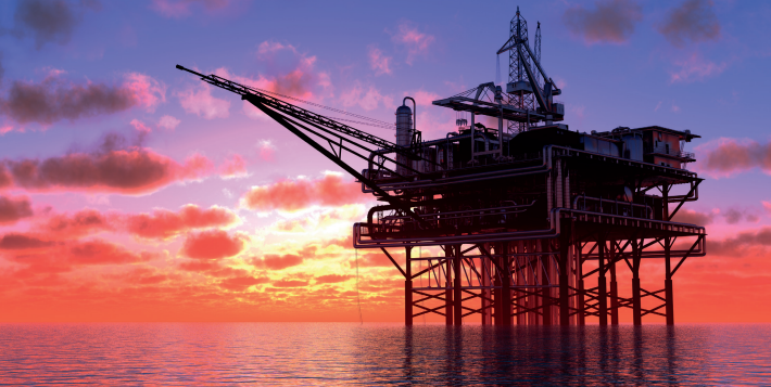 ocean oil and gas drill rig with sunset